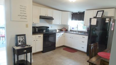 Kitchen has a full size fridge and stove/oven.