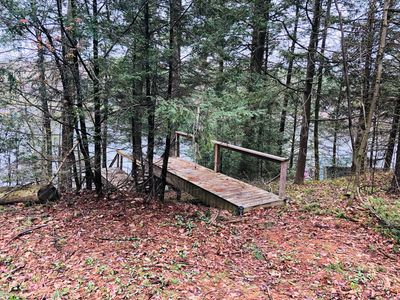 Parking at the top with stairs leading down to the cottage.