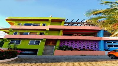 Photo for Colorful new home centrally located with breathtaking ocean and mountain views.