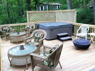 Large deck with hot tub and fire cauldron
