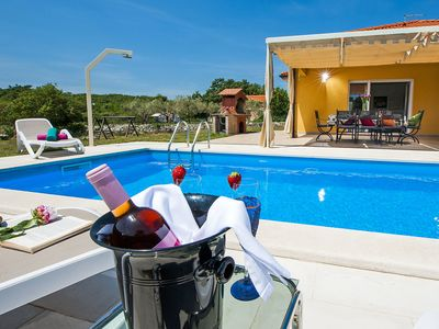 Photo for This 4-bedroom villa for up to 8 guests is located in Rovinj and has a private swimming pool, air-co