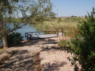 View of Martinez Lake from patio. The deck is right above the 4-slip dock.