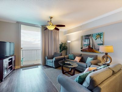 Photo for Colorful & cozy, beachfront getaway w/ a furnished balcony, shared pools, gym