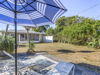 Photo for Lovely getaway with furnished sun room and yard. Close to shops and the beach