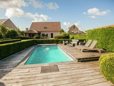 Photo for Beautiful villa with heated swimming pool with jet stream, in the village of Aartrijke