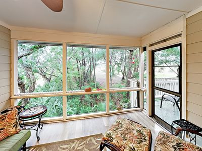Screened Porch - A lovely screened porch offers a great social space.
