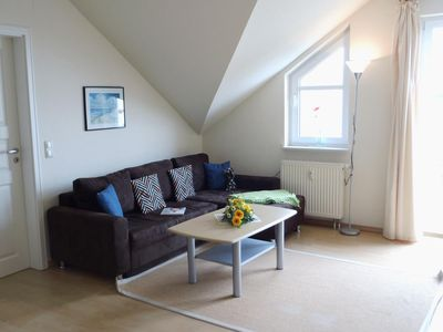 Photo for Spacious apartment on two levels with a beautiful balcony and view to Salzhaff, incl. Use of the wellness area with swimming pool and underground parking - close to the beach and the center