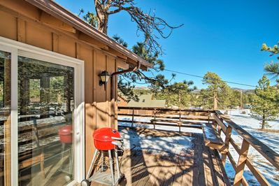 You'll love the large deck, offering a glimpse of the mountains.