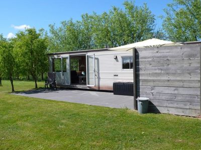 Photo for Spacious 4-person mobile home with a large garden in Vrouwenpolder near the beach