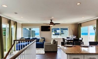 Upstairs living room with deck and views