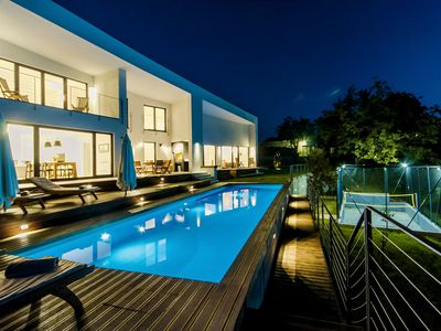 Photo for Modern villa with heated pool, whirlpool, volleyball court and mini football