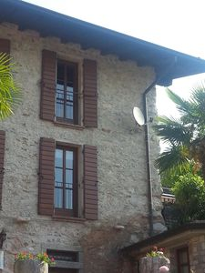 """Photo for Apartment """"Rustico"""" on Lake Garda / Limone, garden, 70 sqm, 5 pers m. Pool access, dog allowed"""