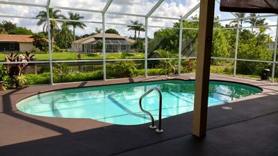 Photo for High ceiling, 2 master bdrm, heated pool house on fresh canal (monthly discount)