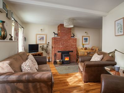 Photo for Lark Cottage is a delightful single-storey cottage located at Champernhayes Farm
