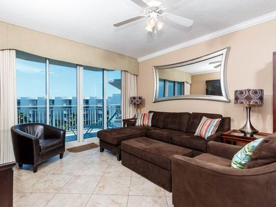 "Photo for Welcoming ""at home"" condo on Okaloosa Island! Free beach chairs! Waterfall + lazy river on-site!"