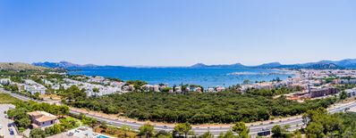 Photo for Modern villa with spectacular views of Pollensa bay, walking distance into town