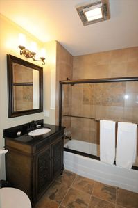 Newly Remodeled Bathrooms with Italian Tile & Granite