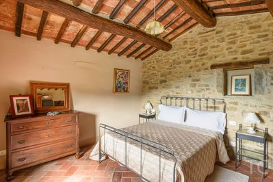 Main bedroom features. (all the windows of the villa have screens , to enjoy warm summer nights