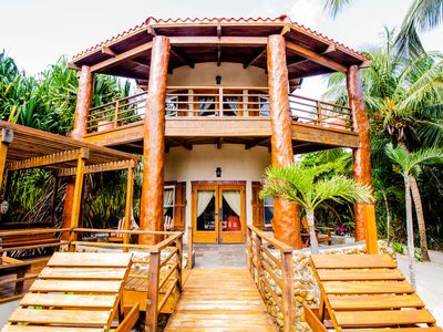 Photo for Stunning Villa, Walk Out to Pool and Beach! Free Golf Cart*