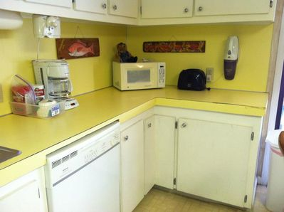 Microwave, electric can opener, toaster, coffee pot, and dishwasher