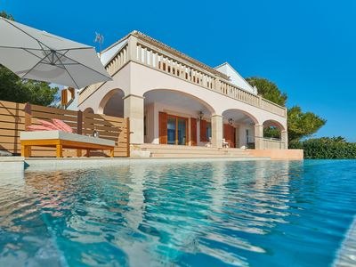 Photo for VILLA VISTAMAR. Spectacular villa with infinity pool and direct sea views