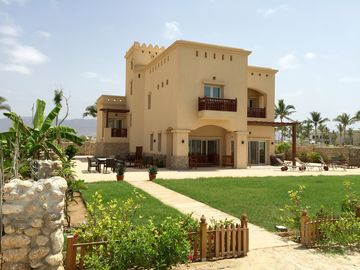 Directly on a  stunning white sand beach in Southern Oman, sits this Beach Villa