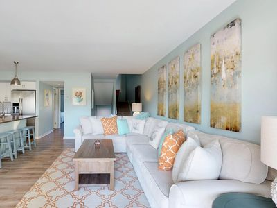 Photo for Welcoming townhouse with shared pool and views of the fairways!