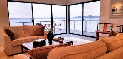Sit on the sofa and view the bay, mountains, sea life & sea birds.  What a view!