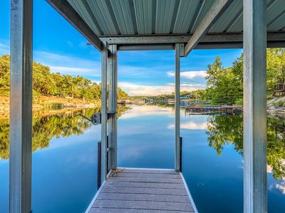 Photo for NEW LISTING! Lakefront home w/boat dock, deck, balcony - close to Austin!