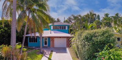 Photo for Beautiful Beach House with pool, lush tropical landscaping steps, from the ocean