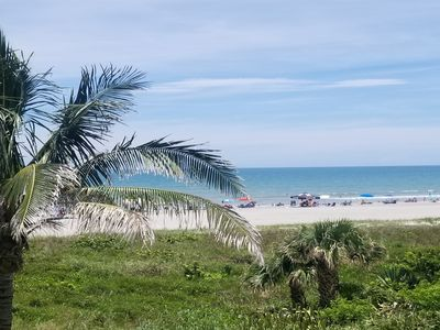 Photo for NEW LISTING! Oceanfront condo w/Tiki theme & shared pool w/gorgeous beach views
