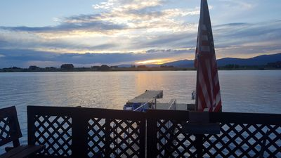 View of Island Park Reservoir and the dock from our deck, facing the sunset.