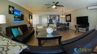 Spacious living area with 2 comfortable futons, large cable TV & DVD player.