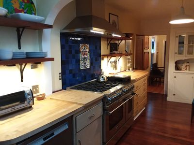 wood and stainless steel throughout the kitchen