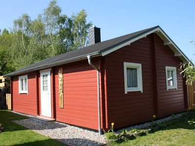 """Photo for 3-room log cabin """"San"""" with fireplace (49m², 4 pers.) - Villa San-Mar with apartment and log cabins near Kühlungsborn"""
