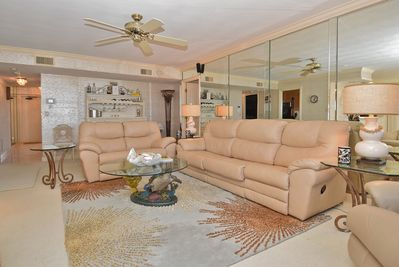 """Living/Family Room. Equipped with a new voice activated remote control 55"""" TV!"""