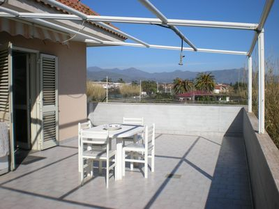 Photo for Apartment near the sea, free wi-fi and parking, splendid view of Mt Etna