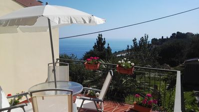 Photo for House in a medieval village with garden-terrace overlooking the sea, 2 bedrooms, Wifi