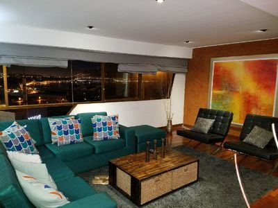 Living room and ocean view at night