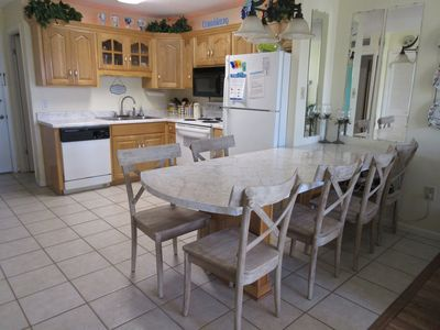 Seating for 6 in fully equipped kitchen.