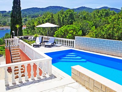 Photo for This 4-bedroom villa for up to 8 guests is located in Vela Luka and has a private swimming pool, air