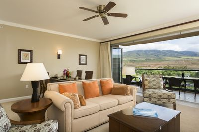Spacious living room and dining area along with the nana doors that open up to the lanai for a seamless outdoor feel inside
