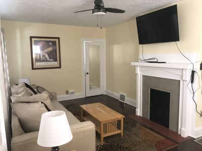 """Living room with 55"""" Smart Tv, DirecTv cable & high speed WiFi."""