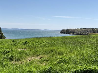 Photo for Rustic vintage cottage in Duck Cove with limited ocean view.