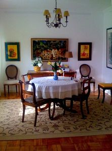 The dining room with art from the family.