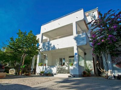 Photo for Holiday apartment with air conditioning, Internet and garden near the beach