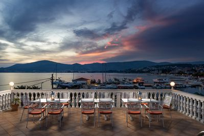 Roof terrace with sea and sunset views