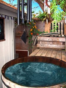 Take a soak in the bubbling cedar wood hot tub
