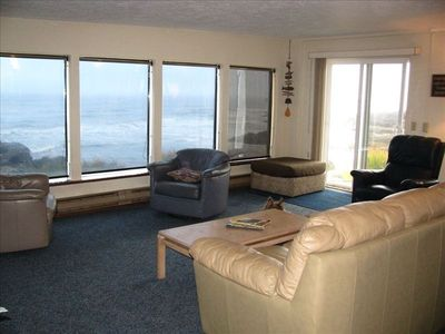 Living room windows face due west; deck just outside