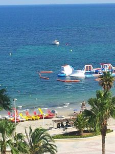 View of the terrace: sea, beach, games for children, and paddleboats